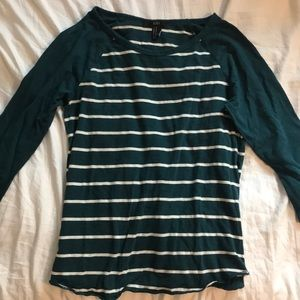 Green striped t shirt.